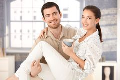 Happy man holding woman in his arms smiling Royalty Free Stock Image