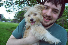 Happy man holding a young Havanese dog Royalty Free Stock Image
