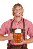 Happy man holds oktoberfest beer stein Royalty Free Stock Photos