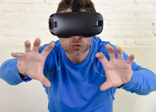 Happy man at home living room sofa couch excited using 3d goggles watching 360 virtual reality. Young modern man at home living room sofa couch excited using 3d stock images