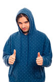 Happy man in hoodie thumbs up Royalty Free Stock Images