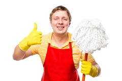 Happy man housewife with a mop in his hand Stock Photography