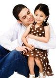 Happy man hugging girl stock image