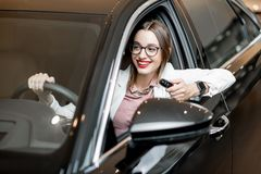 Free Happy Man In A New Car At The Showroom Stock Images - 132859334