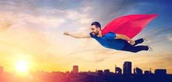 Free Happy Man In Red Superhero Cape Flying Over City Stock Photography - 104073032