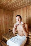 Happy man inside the sauna Stock Photography