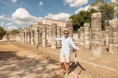 Happy man inviting you to visit the ruins Royalty Free Stock Photo
