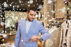 Happy man in jacket with watch at clothing store Royalty Free Stock Photos