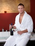 Happy man at jacuzzi with wine glasses Royalty Free Stock Photos