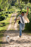 Happy man jogging   with dog Royalty Free Stock Photo