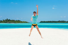 Happy man jump on beach Royalty Free Stock Photos