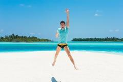 Happy man jump on beach Royalty Free Stock Photos