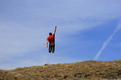 Happy man is jumping in the air Royalty Free Stock Photos