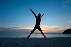 Happy man jumping on the beach Royalty Free Stock Photos