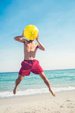 Happy man jumping on the beach Royalty Free Stock Photo