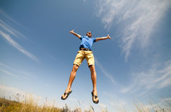 Happy man jumping,. Blue sky on background royalty free stock image