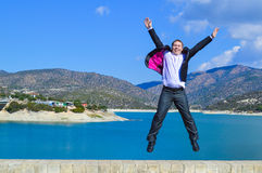 Happy man jumping with joy. One very joyful, happy man jumping up with celebration. Hooray Stock Photos