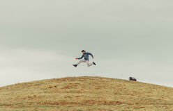 Happy man jumping on the mountain Stock Photos