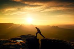 Happy man  jumping between rocks, misty mountains. Royalty Free Stock Photos