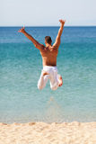 Happy Man Jumping Into Water Stock Photo