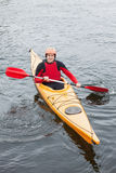 Happy man in a kayak Royalty Free Stock Images