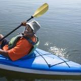 Happy man kayaking. royalty free stock photography