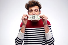 Happy man kissing dollar bill Royalty Free Stock Photography
