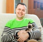 Happy man with  kitten Stock Photos