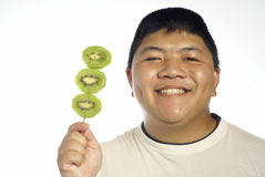 Happy man and kiwi fruit Royalty Free Stock Image