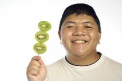 Happy man and kiwi fruit Royalty Free Stock Image
