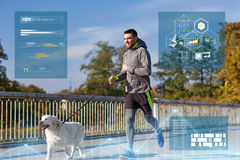 Happy man with labrador dog running outdoors Stock Photos