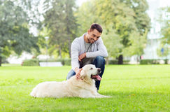 Happy man with labrador dog walking in city Stock Images
