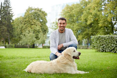 Happy man with labrador dog walking in city Royalty Free Stock Photo