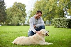 Happy man with labrador dog walking in city Stock Photos