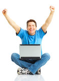 Happy man with laptop stock images