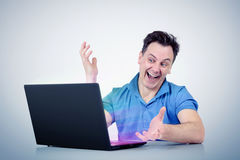 Happy man with laptop computer Royalty Free Stock Photo