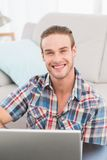 Happy man on a laptop Stock Images