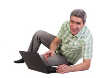 Happy man with the laptop Royalty Free Stock Image