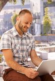 Happy man with laptop outdoors Royalty Free Stock Photo