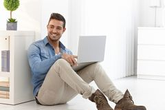 Happy man with laptop Stock Photo