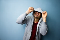 Happy man laughing from under his hoodie Royalty Free Stock Photos