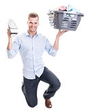 Happy man with laundry basket and iron Stock Image
