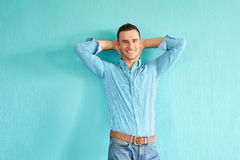 Happy man leaning against a wall Stock Photo