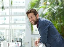 Happy man leaning inside bright building Stock Photography