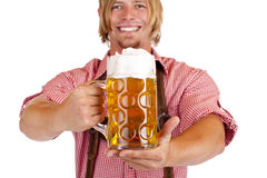 Happy man with leather trousers holds beer stein Stock Photos