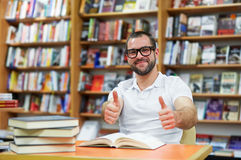 Happy man in the library Royalty Free Stock Images