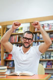 Happy man in the library Stock Image