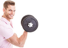 Happy man lifting weights stock image