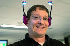 Happy Man With Lights on Ears Stock Photos