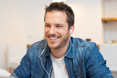 Happy man listening music Royalty Free Stock Images